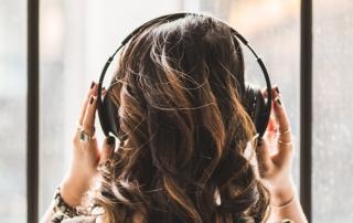 Girl listening to easy Spanish songs